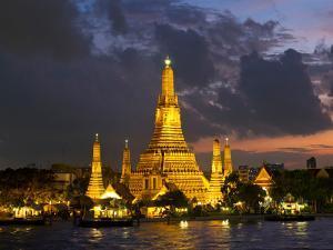 Buddhist Temple Lit Up at Dawn, Wat Arun, Chao Phraya River, Bangkok, Thailand