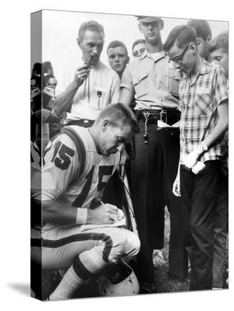 Buffalo Bills Player Jack Kemp Signs His Autograph for a Boy on August 4, 1964