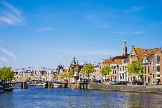 Buildings along the Spaarne River with Gravestenenbrug drawbridge, Haarlem, North Holland, Netherla-Jason Langley-Photographic Print