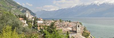 Buildings at the Waterfront with Snowcapped Mountain in the Background, Gargnano, Monte Baldo--Photographic Print