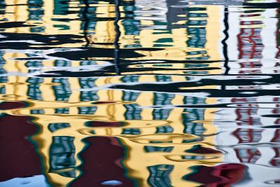 Buildings Reflected in Ripples in a Harbor-Karine Aigner-Photographic Print