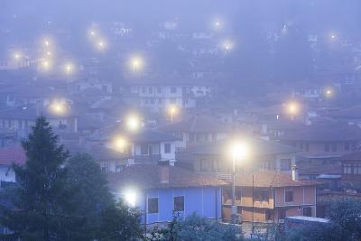Bulgaria, Central Mountains, Koprivshtitsa, Village in Morning Fog-Walter Bibikow-Photographic Print