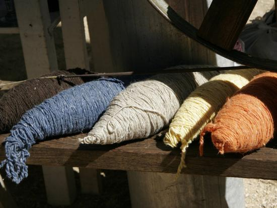 Bundles of Colorful Wool Yarn on Rustic Wool Spinner, California-Gina Martin-Photographic Print