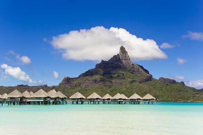 Bungalows on Stilts in a Lagoon with Mount Otemanu in the Near Distance-Mike Theiss-Photographic Print