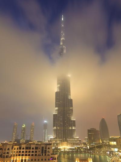 Burj Khalifa Illuminates the Clouds and Surrounding Skyline at Night, Downtown, Dubai, Uae-Amanda Hall-Photographic Print