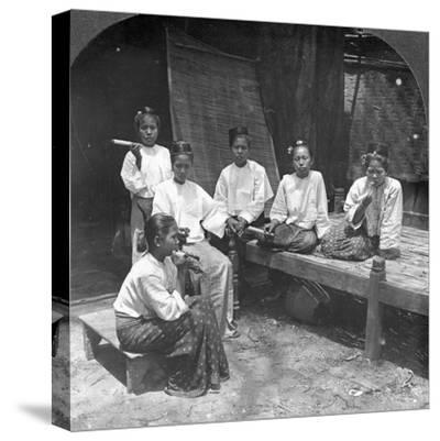 Burmese Women Smoking Outside their Home, Mandalay, Burma, 1908