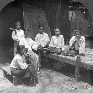 Burmese Women Smoking Outside their Home, Mandalay, Burma, 1908