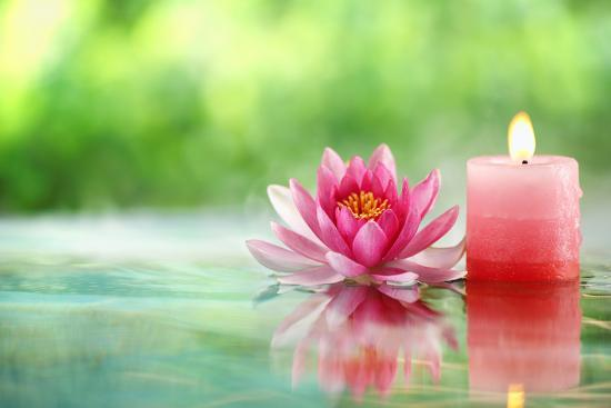 Burning Candle and Water Lily in Water.-Liang Zhang-Photographic Print