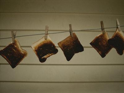 https://imgc.artprintimages.com/img/print/burnt-toast-hanging-on-clothesline_u-l-p3qdph0.jpg?p=0