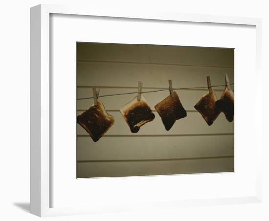 Burnt Toast Hanging on Clothesline-Todd Gipstein-Framed Photographic Print