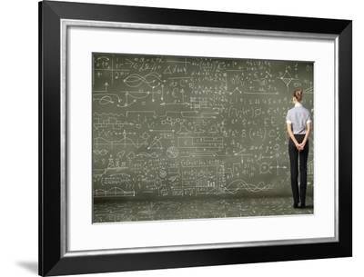 Business Person Standing Against the Blackboard with a Lot of Data-Sergey Nivens-Framed Photographic Print