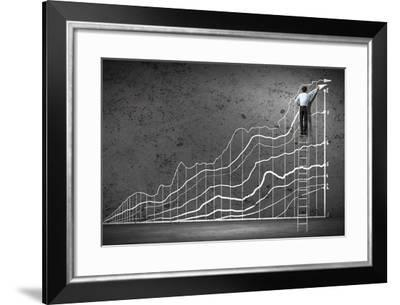 Businessman Drawing Graphics on Wall-Sergey Nivens-Framed Photographic Print