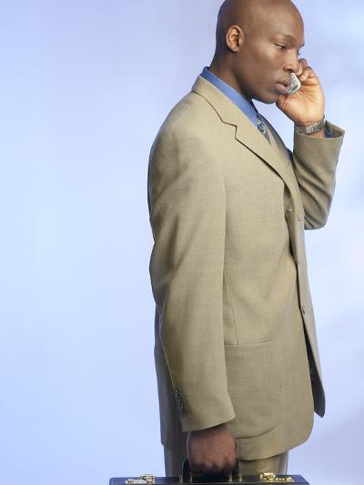 Businessman Talking on Cell Phone--Photographic Print