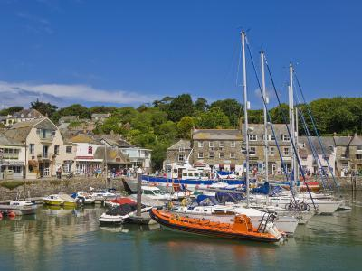 Busy Tourist Shops, Small Boats and Yachts at High Tide in Padstow Harbour, North Cornwall, England-Neale Clark-Photographic Print