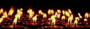 Butter lamps lit for the sacred full moon of July in Lo Manthang, Mustang Region, Nepal
