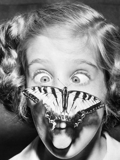 Butterfly Perched on Girl's Nose--Photographic Print