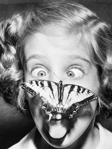 Butterfly Perched on Girl's Nose