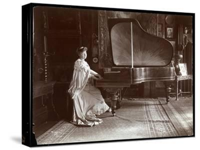 Mrs. I. M. Clark Seated at a Grand Piano, 1904
