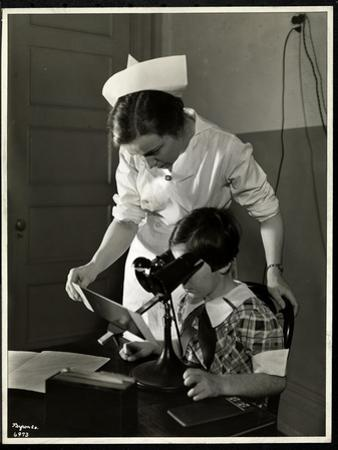 Nurse and a Visually Impaired Girl at the Clinic of the New York Association for the Blind, 114… by Byron Company
