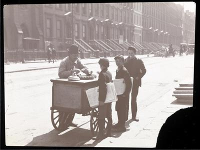 View of an Ice Cream Peddler on the Street, with Three Newsboys Buying Ice Cream, New York, c.1901