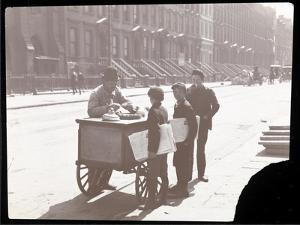 View of an Ice Cream Peddler on the Street, with Three Newsboys Buying Ice Cream, New York, c.1901 by Byron Company
