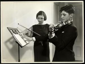 Woman Teaching a Blind Young Man to Play the Violin at the New York Associa by Byron Company