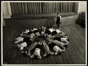 Young Blind Women Lying in a Starburst Pattern on the Floor of the Gymnasium at the New York… by Byron Company