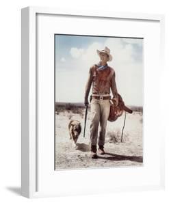 "ca., 1953 --- Actor John Wayne on the movie set of ""Hondo"" (Hondo, L'Homme du Desert), directed by"