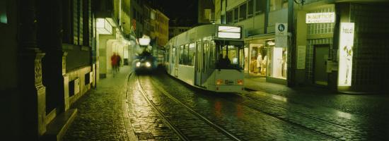 Cable Cars Moving on a Street, Freiburg, Germany--Photographic Print