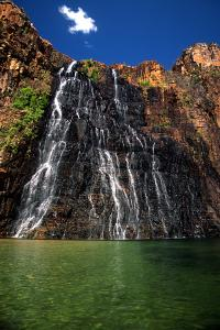 A Scenic View of Cascading Twin Falls Waterfall in Kakadu National Park by Cagan Sekercioglu