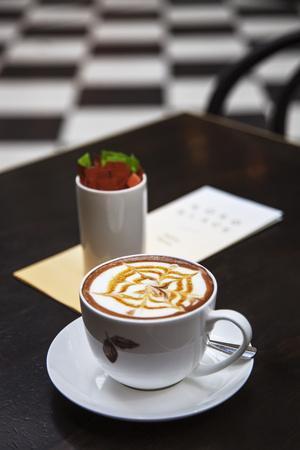 A Cup of Cappuchino in the Royal Arcade, Bourke Street, Melbourne, Victoria, Australia.