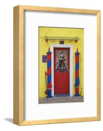 Colourful, Ornate Traditional Doorway and Striped Mooring Posts in the Town of Burano, Venice