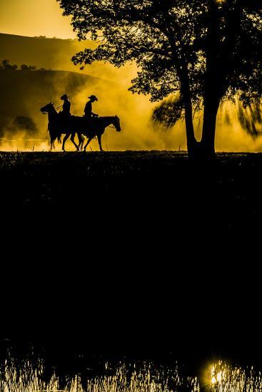 California, Parkfield, V6 Ranch silhouette of two riders faced opposite directions on horseback.-Ellen Clark-Photographic Print