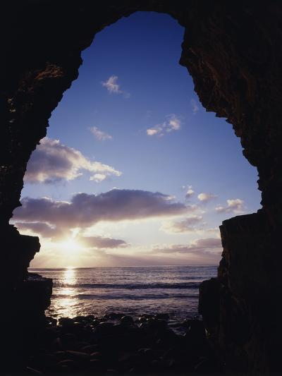 California, San Diego, Sunset Cliffs, Sunset Seen Through a Sea Cave-Christopher Talbot Frank-Photographic Print