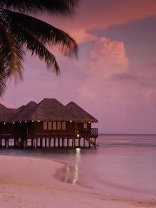 Beach and Water Villas at Sunset, Maldive Islands, Indian Ocean by Calum Stirling