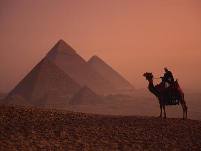 Camel and Rider at Giza Pyramids, UNESCO World Heritage Site, Giza, Cairo, Egypt-Howell Michael-Photographic Print