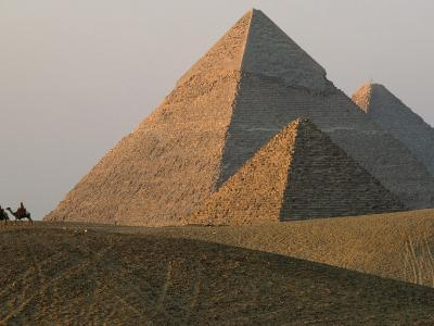 Camel Riders are Dwarfed by the Pyramids of Giza-James L^ Stanfield-Photographic Print