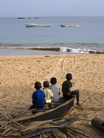 Four Small Boys Look Out to Sea from Where They Sit on Bamboo Fishing Boat on Island of Princip�