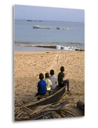 Four Small Boys Look Out to Sea from Where They Sit on Bamboo Fishing Boat on Island of Princip?
