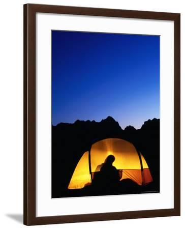 Camper Reading by Lantern in Tent at Dusk, Yosemite National Park, USA-Woods Wheatcroft-Framed Photographic Print