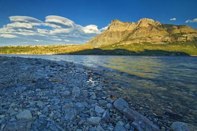 https://imgc.artprintimages.com/img/print/canada-alberta-waterton-lakes-national-park-sunrise-on-vimy-ridge-and-lower-waterton-lake_u-l-q1dfav10.jpg?p=0
