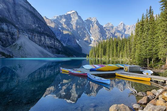 Canoes on boat dock at Moraine Lake, Banff National Park