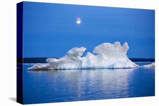 Canada, Nunavut, Moon Rises Behind Melting Iceberg in Frozen Channel-Paul Souders-Stretched Canvas Print