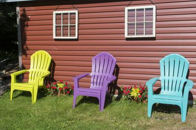 Canada, Peggyu0027s Cove, Nova Scotia, Barn With Colorful Adirondack Chairs  With Flowers