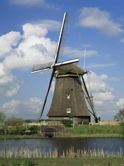 Canal and Windmill at Kinderdijk, Unesco World Heritage Site, Holland-Gavin Hellier-Photographic Print