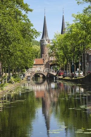 https://imgc.artprintimages.com/img/print/canal-scene-with-bridge-16th-century-east-port-gate-towers-delft-holland-europe_u-l-q12qnf10.jpg?p=0
