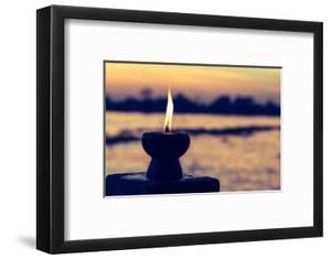 Candle Light Fire Lamp Nearby Abstract Background River during Sunset or Sunrise in Countryside. Me