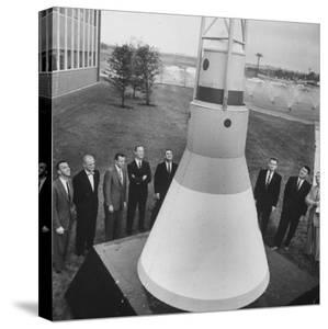 Canidates for 1st Man into Space Standing with Model of Capsule for Project Mercury
