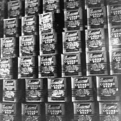 Canned Corn Beef Waiting to Be Exported-Hart Preston-Photographic Print