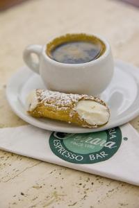 Cannoli and Espresso at Ferrara's Pasticceria Espresso Bar in Little Italy, New York